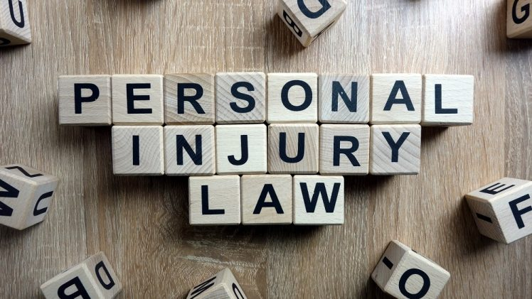 Personal injury law text from wooden blocks on desk