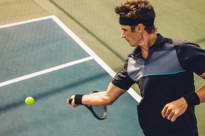 Professional tennis player hitting forehand